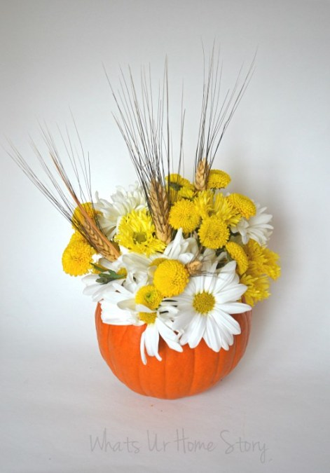 Do you want to get even more use out of your Halloween pumpkin decorations? The answer is provided to us by What's Ur Home Story in the form of a Pumpkin Floral Centerpeice.