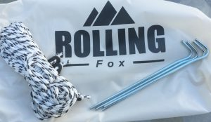 Rolling Fox includes four stakes and four guy lines with the tarp.