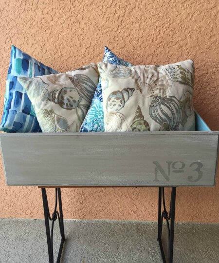 This is such an adorable upcycled DIY backyard project for your storage needs.