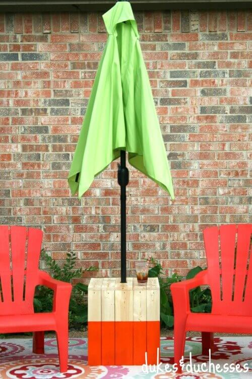Dukes and Duchesses provide the DIY instructions to build your own Color Block Umbrella Table. It is really cute but truth be told my favorite thing is that it provides a nice place for my drink. :)