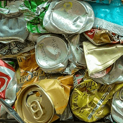 soda and beer cans in landfill
