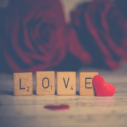 love Scrabble with red roses