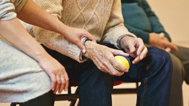 elderly people with an exercise ball